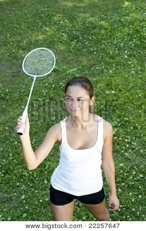 Beautiful Young Woman Playing Badminton