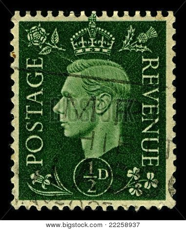 ENGLAND-CIRCA 1937:A stamp printed in ENGLAND shows image of George VI  was King of the United Kingdom and the Dominions of the British Commonwealth from 11 December 1936 until his death, circa 1937.