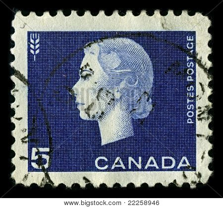 CANADA-CIRCA 1962:A stamp printed in CANADA shows image of Elizabeth II (Elizabeth Alexandra Mary, born 21 April 1926) is the constitutional monarch of United Kingdom in blue, circa 1962.
