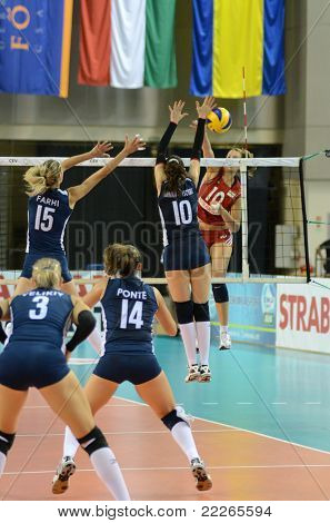 DEBRECEN, HUNGARY - JULY 8: Unidentified players in action at a CEV European League woman's volleyball game Hungary (Red) vs Israel (Blue) on July 8, 2011 in Debrecen, Hungary.