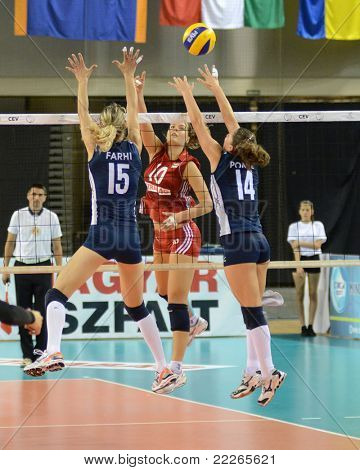 DEBRECEN, HUNGARY - JULY 8: Dora Horvath (in red) in action at a CEV European League woman's volleyball game Hungary (Red) vs Israel (Blue) on July 8, 2011 in Debrecen, Hungary.