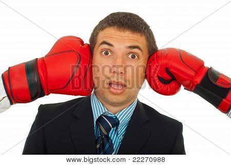 Surprised Man Between Boxing Gloves