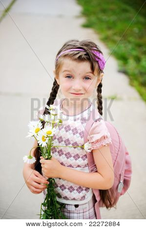 Young girl with pink bagpack ready for school