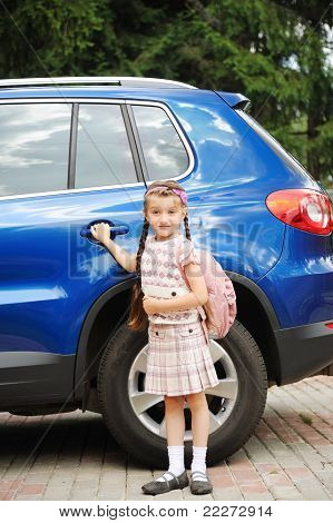 Young girl with pink bagpack ready to go to school