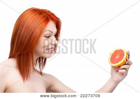 red woman holding grapefruit