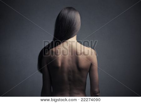 Rear view of a beautiful woman with long straight hair