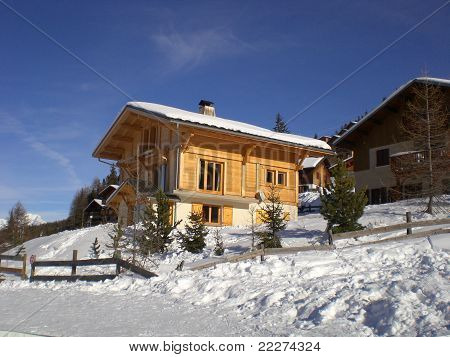 Snowy Wooden Chalet