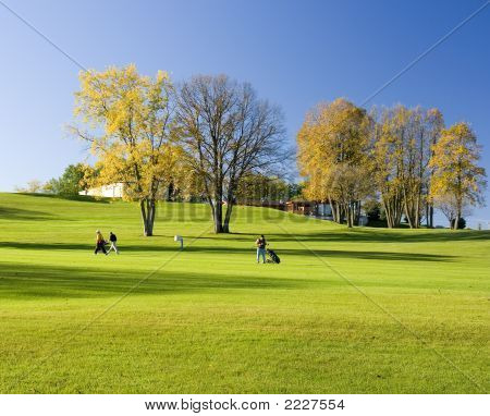 Andando de golfistas no Outono