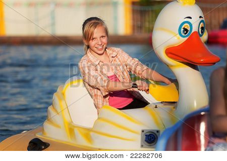 Teenage girl having fun in a water park