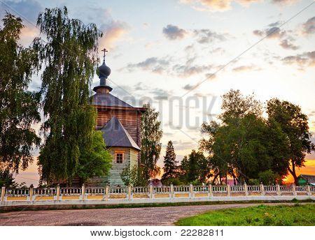 Old russian church under evening sky. fisheye lens