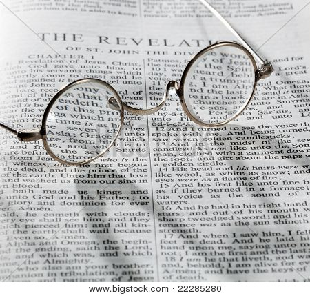 Antique Reading Glasses On Page Of Bible