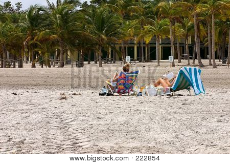 Women Reading On Beach