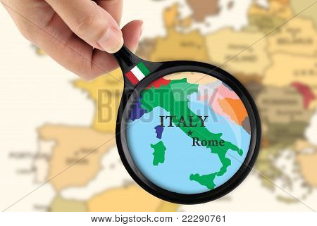 Magnifying Glass Over A Map Of Italy