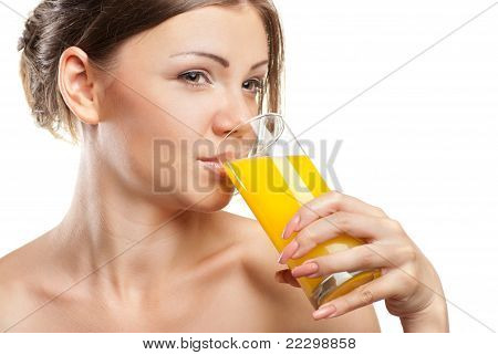 Young beautiful woman drinking orange juice