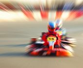 stock photo of karts  - Abstract red slow motion speed background selective focus on race kart karting competition extreme sport - JPG