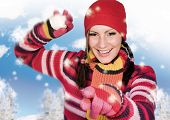 stock photo of winter sport  - Girl in winter clothing throwing a snowball - JPG