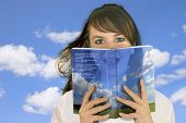 image of girl reading book  - Woman reading a book  - JPG