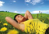 girl lying in a meadow enjoying the sun. More pictures like this in my portfolio.