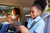 Children Using Digital Devices On Car Journey poster