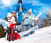 picture of snowball-fight  - cute family having fun in the snow - JPG