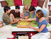 picture of boardgame  - a young family is playing board - JPG