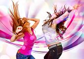 stock photo of sassy  - two young girls dancing in discolight - JPG