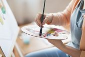 art, creativity and people concept - close up of artist with palette and brush painting still life o poster