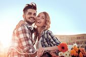 Happy Couple In Love Having Fun Outdoors. poster