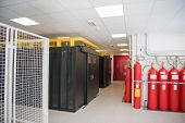 modern server room with black servers and hardwares in a internet data center poster