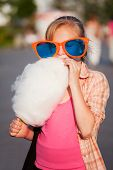 image of candy cotton  - Girl eating cotton candy - JPG