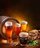 stock photo of keg  - Still Life with a keg of beer and draft beer by the glass - JPG