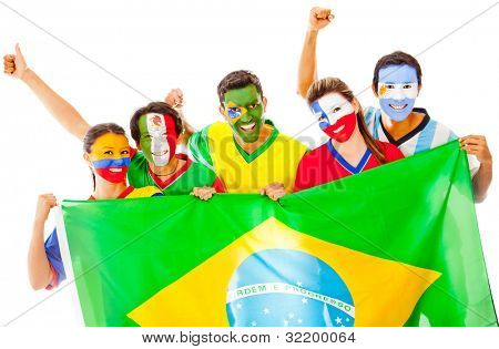 Happy Latin group holding the Brazilian flag - isolated over white