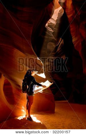 Female explorer inside a cave at the Grand Canyon
