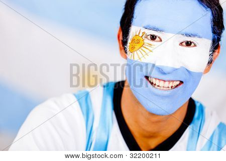 Portrait of an Argentinean man with the flag painted on his face