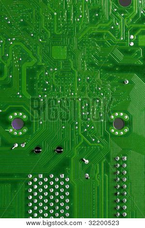 Close up of computer circuits in green tones