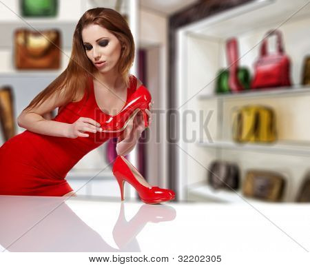 women  in shop and thinking what shoes to buy