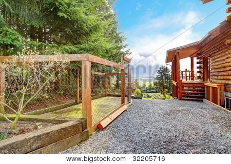 Log Cabin With Dogs Fenced Canal Area Behind The House.