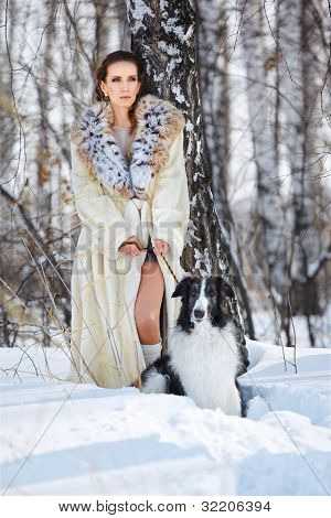Woman With Wolfhound Outdoors