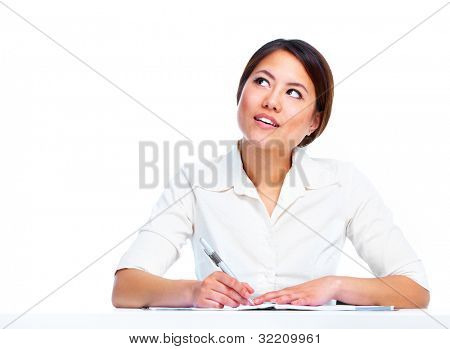 Young asian business woman writing. Isolated on white background.