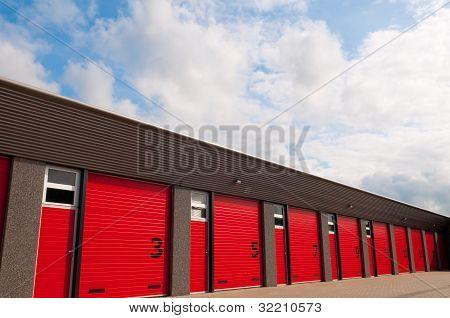 Storage Building With Red  Numberd Doors