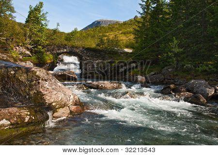 The Bridge Through The Mountain River