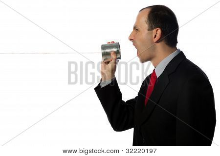 Businessman Yelling Through An Oldschool Can Phone, Horizontal, Close Up