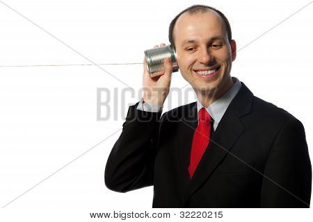Man Listening Through An Oldschool Can Phone And Laughing