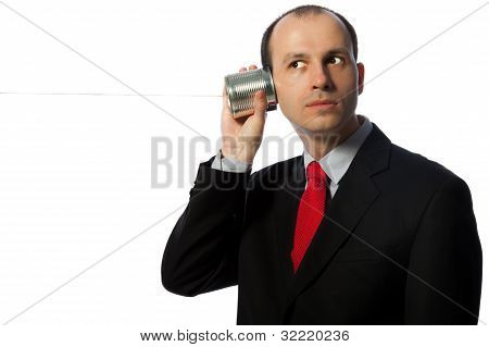 Man Listening Through An Oldschool Can Phone