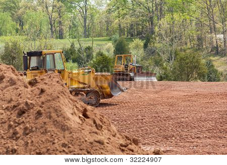Large Earth Mover Digger Clearing Land