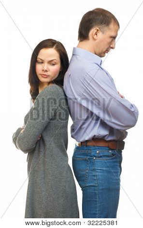 Couple having relationship difficulties, standing back to back. Isolated on white background