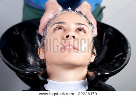 Young Woman Getting A Hairwash In A Hair Salon. Selective Focus.