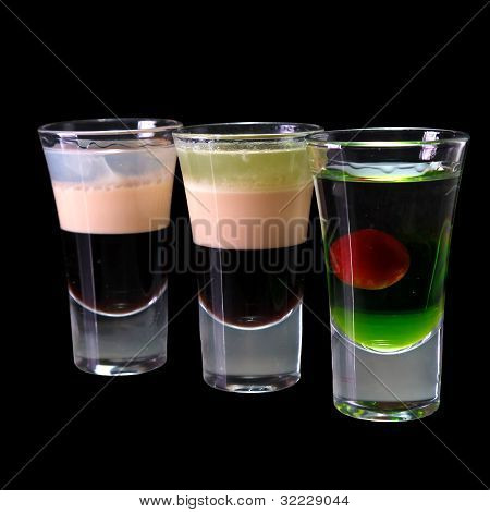 three cocktails layered shots isolated