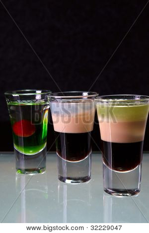 three cocktails layered shots