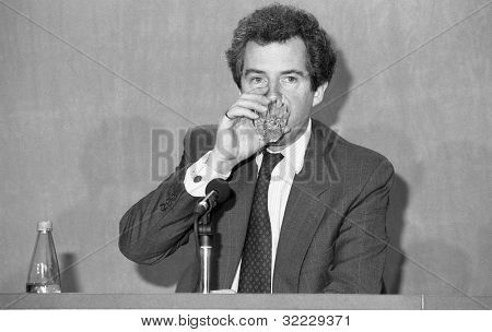 LONDON - FEBRUARY 28: Rt.Hon. William Waldegrave, Secretary of State for Health and Conservative M.P. for Bristol West, drinks water during a press conference on February 28, 1992 in London.